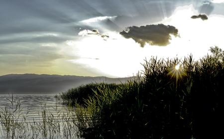 Photo pour dusk scene over lake prespa in macedonia,image - image libre de droit