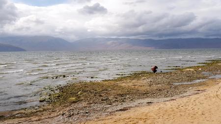 Photo pour Lake Prespa, Macedonia, photographer taking pictures of a nature - image libre de droit