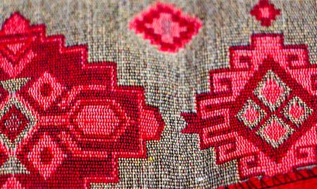 Foto de colorful geometric shapes of a carpet, top view - Imagen libre de derechos