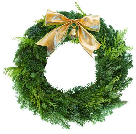 Foto de green christmas wreath woth golden bow  - Imagen libre de derechos
