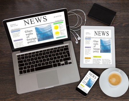 Photo for modern computer devices with news site - Royalty Free Image