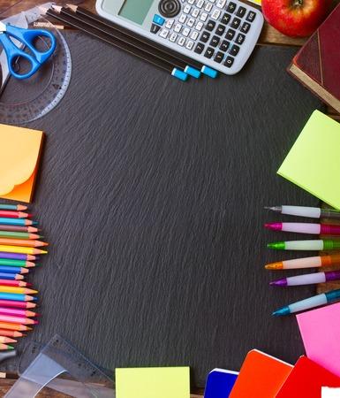 Foto de Back to school supplies as a frame on blackboard - Imagen libre de derechos