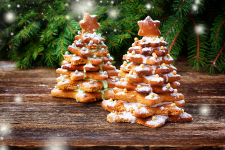 Photo for two gingerbread christmas tree with evergreen twing, retro toned - Royalty Free Image