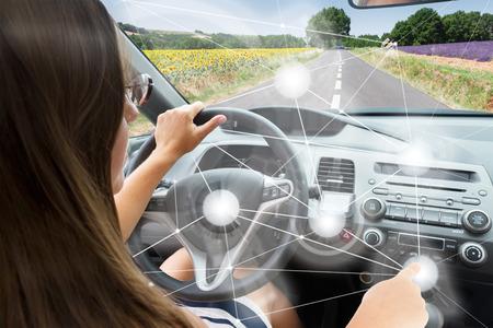 Photo pour Self-driving car concept - woman driving modern car - image libre de droit