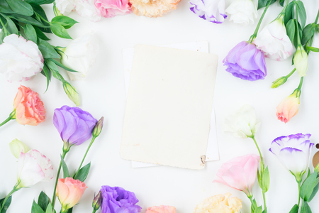 Photo for Pink, white and violet eustoma flowers frame and blank aged paper notes - Royalty Free Image
