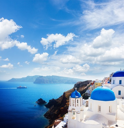 Photo for volcano caldera with blue church domes at sunny day with cloudy sky, Oia, Santorini - Royalty Free Image