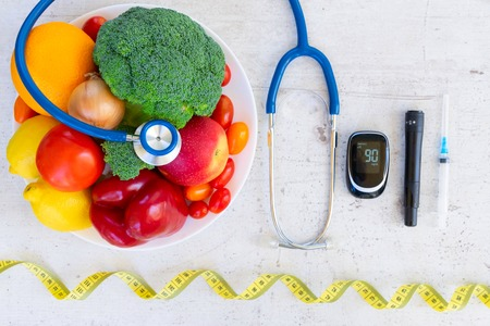 Foto per raw vegetables and fruits with blood glucose meter and insulin syringe, diabetes healthy diet concept - Immagine Royalty Free