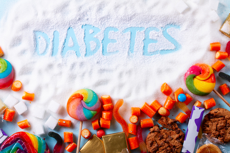 Foto per Sweets with sugar, flat lay top view scene with word diabetes - Immagine Royalty Free