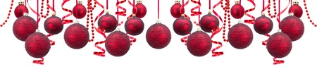 Foto de Row of red and golden christmas balls with garlands wide banner isolated over white background - Imagen libre de derechos