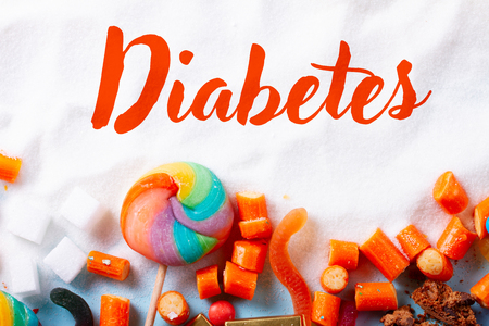 Foto per Sweets and candies with sugar, flat lay with word Diabetes - Immagine Royalty Free