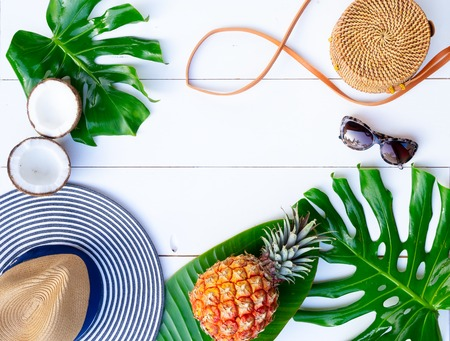 Foto per Summer flat lay frame with hat, bag, leaves and fruits on white background with copy space - Immagine Royalty Free
