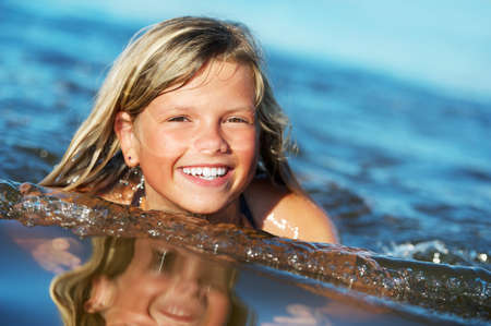 Photo for Happy girl in the water - Royalty Free Image