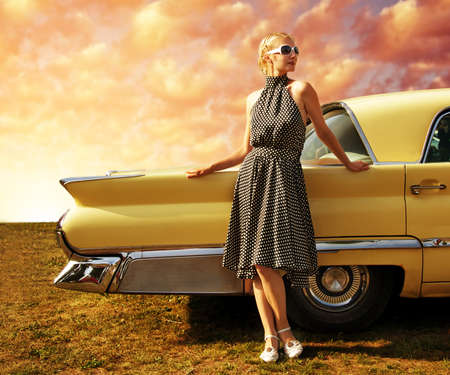 Foto per Beautiful lady standing near retro car. - Immagine Royalty Free