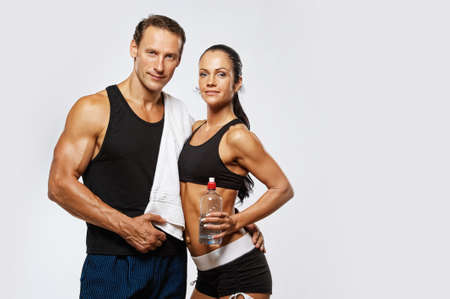 Photo for Athletic man and woman after fitness exercise - Royalty Free Image