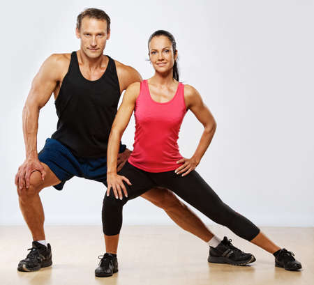Photo for Athletic man and woman doing fitness exercise - Royalty Free Image