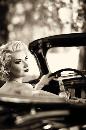 Photo for Retro woman behind wheel - Royalty Free Image