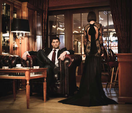 Photo pour Elegant couple in formal dress in luxury cabinet  - image libre de droit
