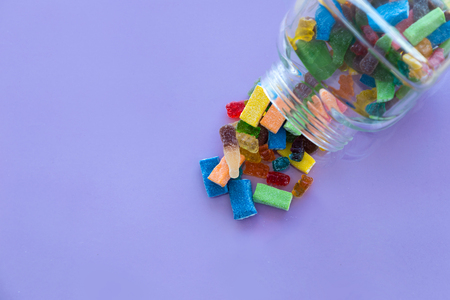 Photo for Close-up of colorful jelly candies in a bottle. Addiction concept. - Royalty Free Image