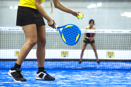 Photo for Portrait of two young women playing paddle tennis. - Royalty Free Image