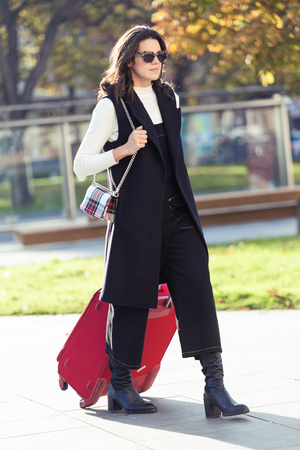 Photo for Shot of pretty young woman walking with suitcase to the train station. - Royalty Free Image
