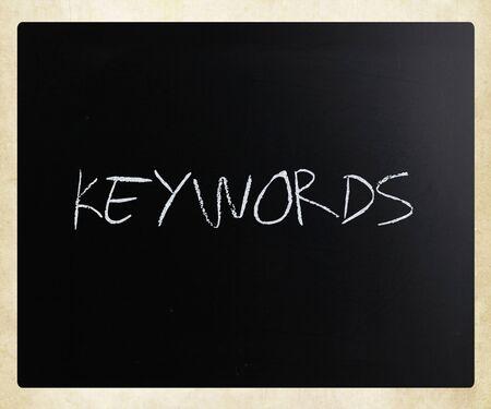 Foto de The word Keywords handwritten with white chalk on a blackboard. - Imagen libre de derechos