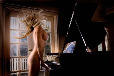 Anonymous nude of model head banging while playing piano