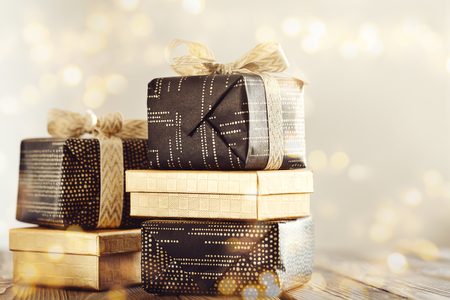 Photo for Arrangement of wrapped presents with ribbons in golden glitters.  - Royalty Free Image