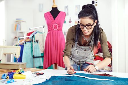 Photo pour Designer drawing on a textile material - image libre de droit