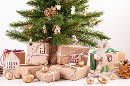 Foto de Beautiful decorated christmas tree with wrapped gifts. Christmas and new year celebration concept - Imagen libre de derechos