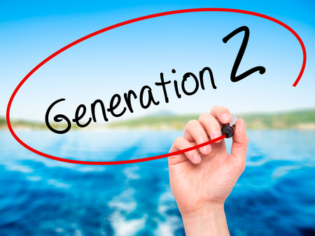 Man Hand writing Generation Z with black marker on visual screen. Isolated on nature. Business, technology, internet concept. Stock Image