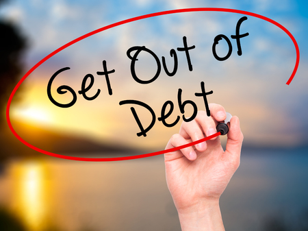 Foto de Man Hand writing Get Out of Debt with black marker on visual screen. Isolated on nature. Business, technology, internet concept. Stock Image - Imagen libre de derechos