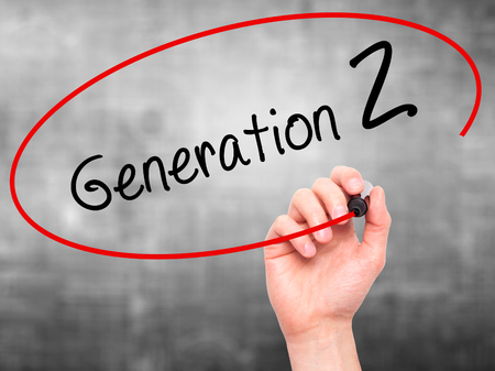 Man Hand writing Generation Z with black marker on visual screen. Isolated on grey. Business, technology, internet concept. Stock Image