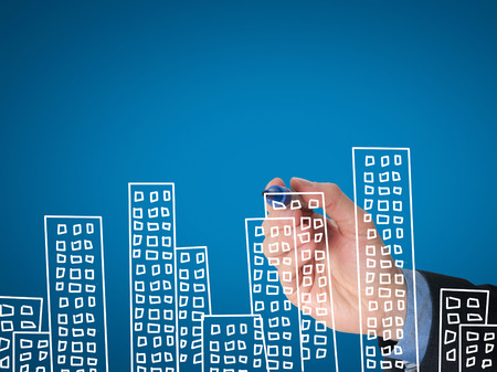 Photo for Business man hand drawing apartments on visual screen. Business concept. Isolated on blue. Stock image. - Royalty Free Image