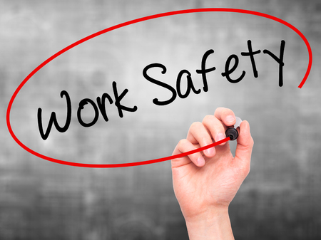 Photo pour Man Hand writing Work Safety with black marker on visual screen. Isolated on grey. Business, technology, internet concept. Stock Photo - image libre de droit
