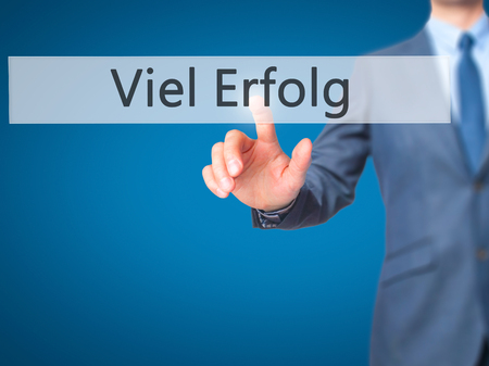 Viel Erfolg  (Much Success In German) - Businessman hand pressing button on touch screen interface. Business, technology, internet concept. Stock Photo