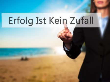 Erfolg Ist Kein Zaufall (Success Is No Accident in German) - Businesswoman hand pressing button on touch screen interface. Business, technology, internet concept. Stock Photo
