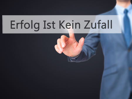 Erfolg Ist Kein Zaufall (Success Is No Accident in German) - Businessman hand pressing button on touch screen interface. Business, technology, internet concept. Stock Photo