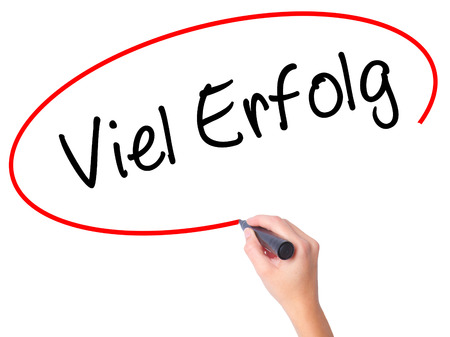 Women Hand writing Viel Erfolg (Much Success In German) with black marker on visual screen. Isolated on white. Business, technology, internet concept. Stock Photo