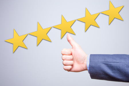 Photo pour Review, rating, ranking, evaluation and classification concept. Businessman is satisfied with company 5 stars rating. Isolated on white - image libre de droit