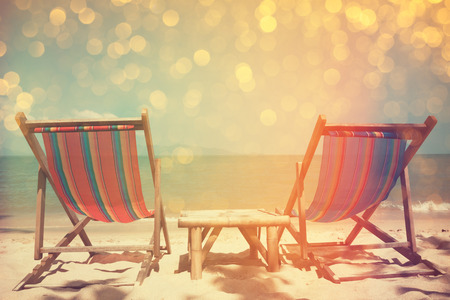 Photo for Beach chairs on sea shore with glowing bokeh and film stylized, double exposure effect - Royalty Free Image