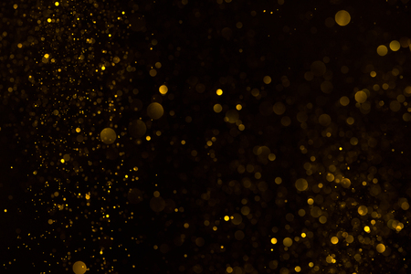 Photo for Gold glitter falling sparkle background on black - Royalty Free Image