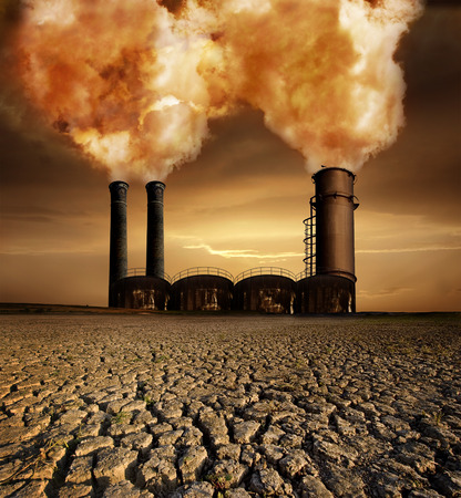 Foto de Global Warming and pollution theme with chimneys;gas and dry land - Imagen libre de derechos