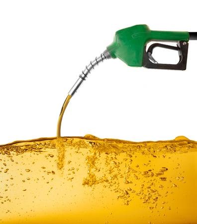Photo pour Noozle pumping gasoline in a tank - image libre de droit