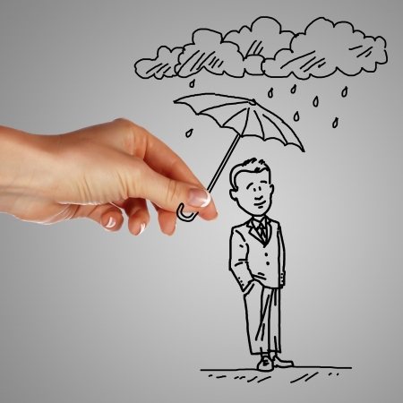 Man standing under the rain and protected with umbrella