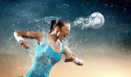 Photo for Image of young woman football player hitting ball - Royalty Free Image