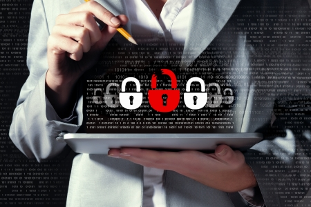 Foto de Businesswoman holding tablet pc entering password  Security concept - Imagen libre de derechos