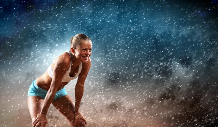 Image of young attractive sport woman exercising