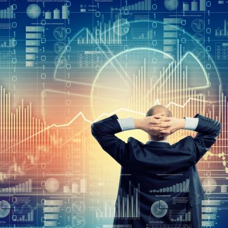 Foto de Back view image of businessman with arms crossed behind head - Imagen libre de derechos