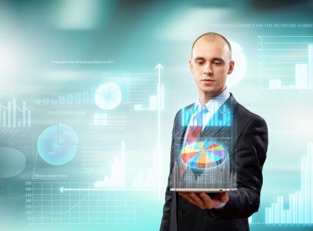 Photo pour Image of businessman with tablet pc against high-tech background - image libre de droit