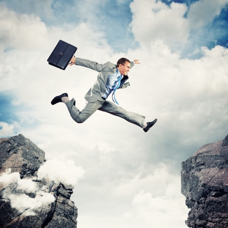 Photo for Image of young businessman jumping over gap - Royalty Free Image
